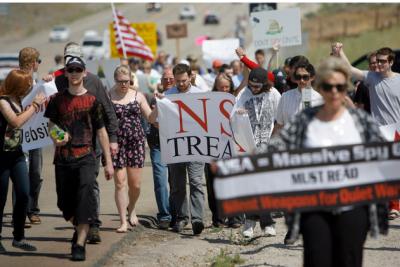 Restore the Fourth-Utah demonstrators line Redwood Highway on July 4 near the NSA data center.